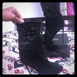Black laser cut peep toe booties