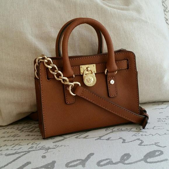 7bb15a2cbd Michael Kors Mini Hamilton Crossbody. M_591ca623c284565dfc1b5b2d. Other Bags  ...