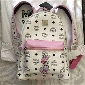 MCM Handbags - MCM rabbit coated backpack / white pink