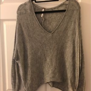 Free People grey V-neck sweater in a small