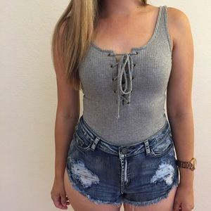ShopBossyJocey Tops - Heather Grey Lace Up Ribbed Bodysuit