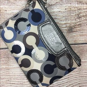 Coach Handbags - Coach small blue wristlet w/ sequins used once.