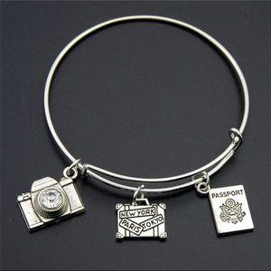 Alex And Ani Jewelry - WANDERLUST WIRE BANGLE CHARM BRACELET