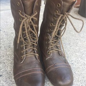 Brown leather combat boots