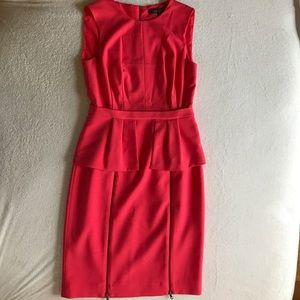 BCBGMAXAZRIA coral peplum dress.