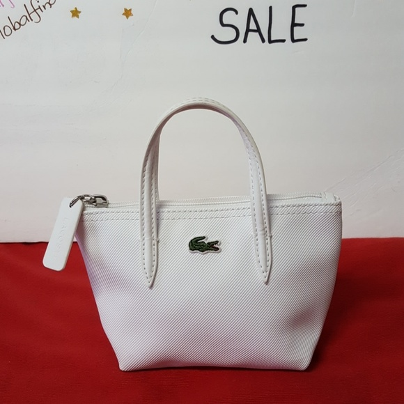9fe354e89 Lacoste Handbags - LACOSTE MINI BAG - Authentic