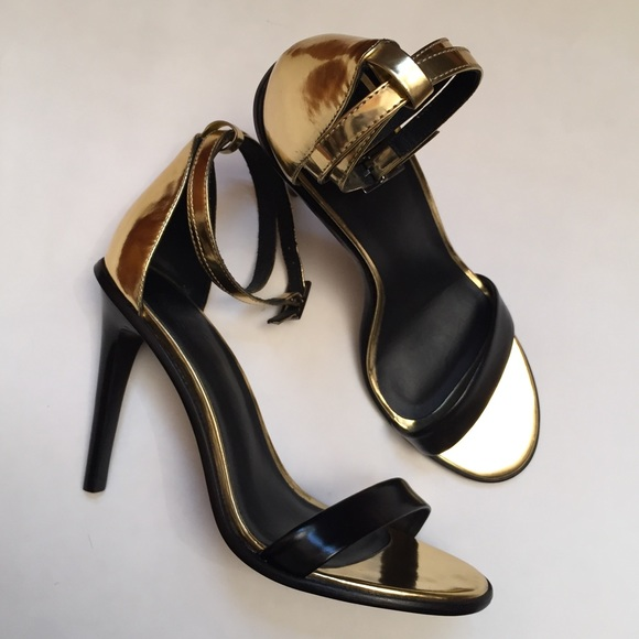 f834db06c06 Tibi Amber Ankle Strap Heels in Gold   Black NWOT.  M 59234c0a7fab3a41c9012a82