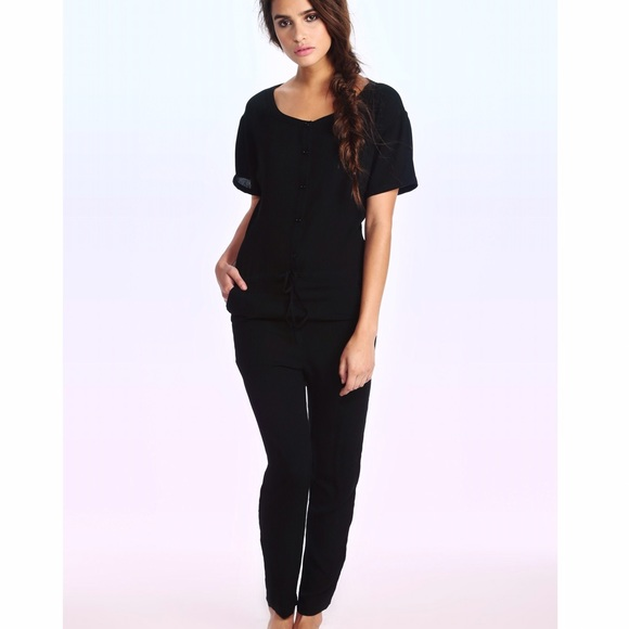 7a615063c9e6 wildfox travel jumpsuit black. M 59234eae3c6f9f6ab1012a26