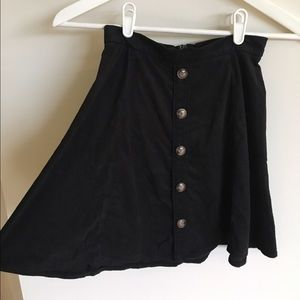 Dresses & Skirts - Black short Suede look mini skirt with buttons