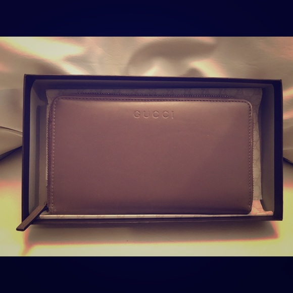 31401c28c2e Gucci Handbags - Pre-loved Gucci XL Zip Around Travel Wallet