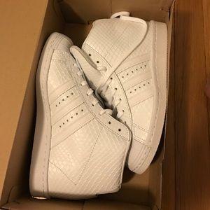 adidas Shoes - Superstar High top Adidas. Never been work. Size 7