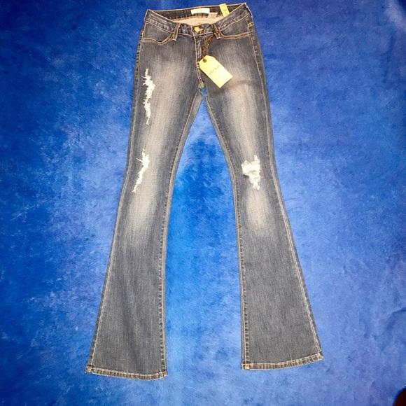 bffeebdbed7 Vibrant MIU Boot-cut Distressed Denim Jeans