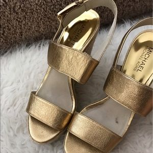 Used Michael kors gold wedge size 8