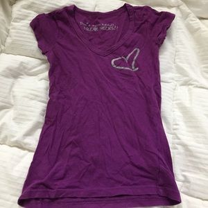Purple t-shirt.