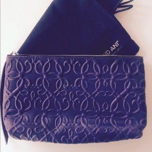 Alex And Ani Handbags - Alex and Ani leather zip clutch