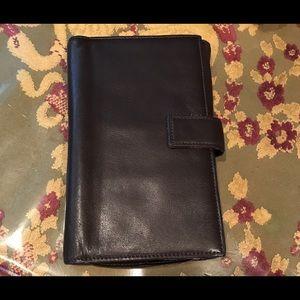 Tumi Handbags - TUMI travelers wallet