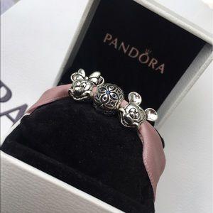 Pandora Jewelry - Two pandora charms and a beautiful extra charm