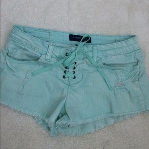 Ocean Drive Pants - Aqua Distressed Corseted Cut Off Jean Shorts