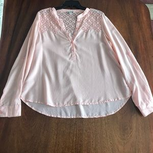 Light pink blouse with patterned cutouts