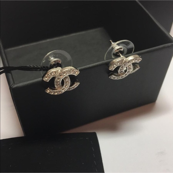 chanel chanel classic silver cc logo stud earrings from