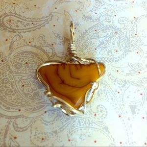 Carved Amber necklace (Pendant). Triad shape in SS