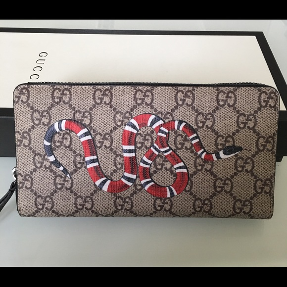 5c3b20e9767 Gucci GG canvas snake zip wallet
