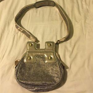 Hogan Handbags - Reposh hogan gold guitar bag
