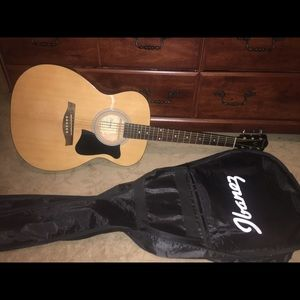 Ibanez acoustic guitar and it's case. for sale