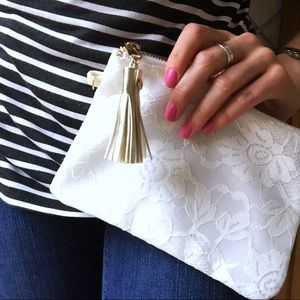 Boutique Handbags - NWOT white lace gold tassel clutch or makeup bag