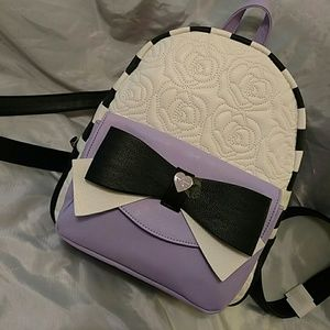 Betsey Johnson Handbags - Betsey Johnson backpack with purple pocket NWT