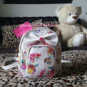 Betsey Johnson Handbags - BETSEY JOHNSON. White Floral Backpack Mini Bag