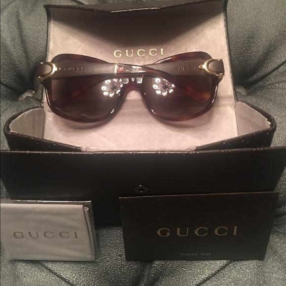 99151d41f4c Gucci leather buckle sunglasses. Gucci. M 592e44776d64bc94b702caac.  M 592ae55f981829ce7f005548. M 592e44786d64bc94b702caad.  M 592e44796d64bc94b702caae