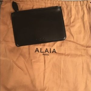 Alaia Handbags - NWOT Alaia Pouch with Dustbag