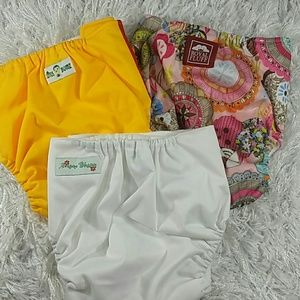 Other - Bundle of 3 Yellows, pinks  cloth diapers. Kid