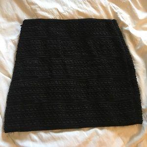 New-like stretchy textured black mini-skirt