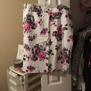 White skirt with pink, black and grey floral print