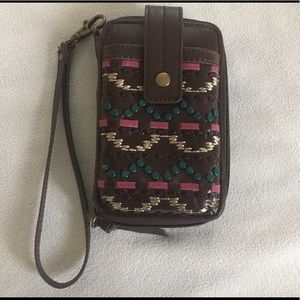 The Sak Wristlet phone pouch credit cards ID
