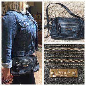 Tignanello Handbags - Tignanello black leather cross body
