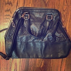 Large black bag with shoulder strap.
