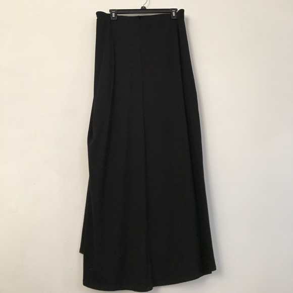With each smooth step you take, all eyes are drawn to the soft sheen of your pleated maxi skirt! The floor-length silhouette and beautiful hues of this maxi beauty ensure a line of compliments as lengthy as the suitors you'll have pining for the next dance.