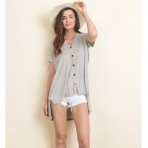Knit high-low with v-neck button up top