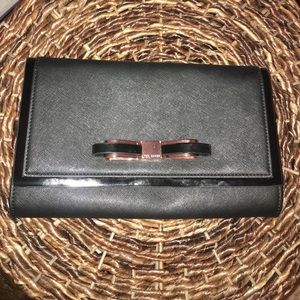 Ted Baker black clutch with rose gold bow