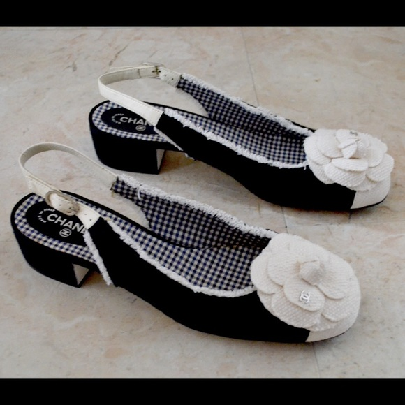 Available In Black And White Flat Sandal T-Strap Flower Detail.