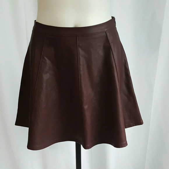 FAUX LEATHER SKATER MINI SKIRT. Super Hot and Trendy. these cute faux leather apparels are now one of the hottest trend right now. looking hot and sexy!