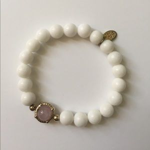 White bead bracelet with gold metal