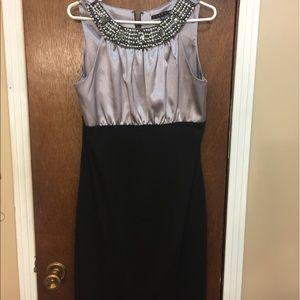 Tiara B. Beautiful dress.  Size 10.