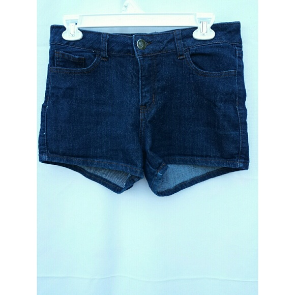 Rolled cuff hem juniors denim shorts can go from super casual to very polished. Wear them with a t-shirt or tank top for a day of hanging at the mall with your friends. Then you can go home and dress them up with a cute blouse, polo, or button down linen shirt for a fun dress casual barbeque.