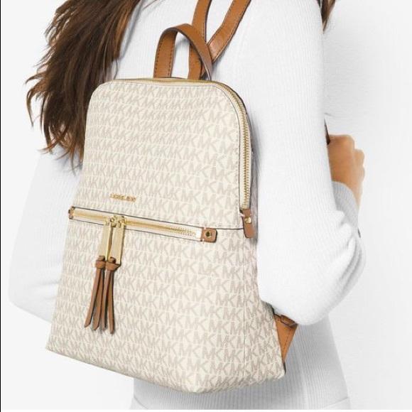 d41a2b6354cd55 Michael Kors Rhea slim backpack. M_592f96d6c2845650b60c86f7