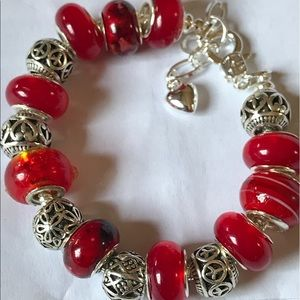 Silver bracelet with silver spacers and red beads