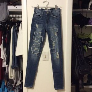Denim - Patched distressed high waisted jeans